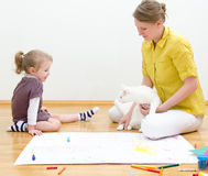 Young woman and little girl drawing Royalty Free Stock Photos