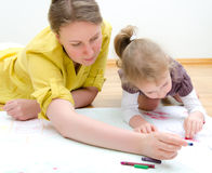 Young woman and little girl drawing Stock Photography