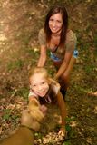 Young Woman And Little Girl In The Forest stock photos