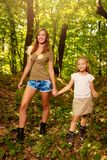 Young Woman And Little Girl In The Forest royalty free stock photography