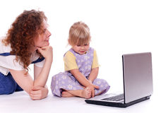 Young woman with little girl looking at laptop Stock Photography