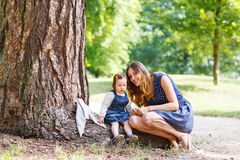 Young woman and little girl of one year walking through summer p Stock Photography