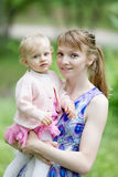 Young woman and little girl in the park Stock Photography