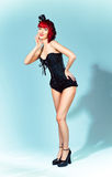 Young woman in little hat and corset in pin-up sty Royalty Free Stock Photo