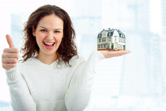 Young woman with little house Stock Photography
