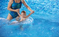 Young woman and little son in swimming pool Stock Images