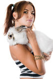 Young woman with little white rabbit Stock Image