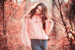 Young woman in Living Coral color of the year 2019. Young woman in Living Coral forest. Color of the year 2019. Main trend natural and authentioncept stock image