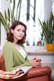 Young woman in the living room 1 Stock Photos