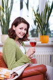 Young woman in the living room 3 Stock Images