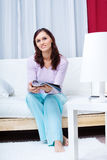 Young woman in the living room Royalty Free Stock Photos