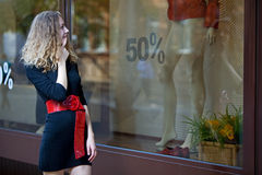 Young woman lokk in shop windows Stock Photo