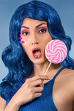 Young woman with lolipop Stock Photo