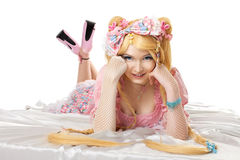 Young woman in lolita costume cosplay isloated. Young woman in lolita costume with gold hair cosplay character isloated royalty free stock photo