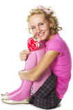 Young woman with lollipop. Smiling young woman with lollipop stock image