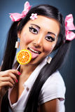 Young woman with lollipop royalty free stock photography