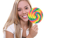 Young woman with lollipop. A young woman with a colorful lollipop Stock Images