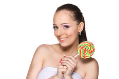 Young woman with lollipop. Royalty Free Stock Images