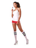Young woman with lollipop. Woman in shorts and shirt with lollipop Royalty Free Stock Photography