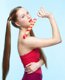 Young woman with lollipop Royalty Free Stock Images