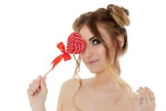 Young woman with lollipop. Stock Photos
