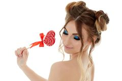 Young woman with lollipop. Royalty Free Stock Photography