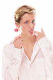 Young woman with lollipop sucking her finger Royalty Free Stock Photo
