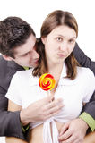 Young woman with lollipop Royalty Free Stock Photos
