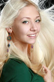 Young woman with long blond hair. Beautiful young woman with long blond hair stock photography