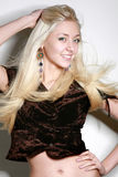 Young woman with long blond hair. Beautiful young woman with long blond hair royalty free stock photos