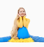Young Woman with Long Blond Hair and Large Blue Egg. Royalty Free Stock Photo