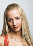 Young woman with long blonde hair. Royalty Free Stock Images