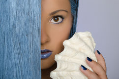 Young woman with long blue hair and shells Royalty Free Stock Photos