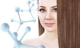 Young woman with long brown hair near big molecule chain. Young woman with long brown hair near big white molecule chain. Over white background. Innovation Stock Photo