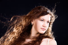 Young woman with long brunette hair portrait Royalty Free Stock Photography