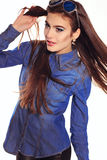 Young woman with long dark hair wears jeanse shirt and sunglasses Stock Images