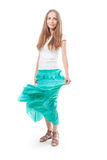 Young woman in a long green skirt Stock Photos