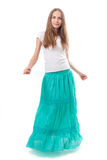 Young woman in a long green skirt Stock Images