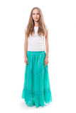 Young woman in a long green skirt Stock Photography