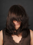 Young woman with long hair. Portrait of a young woman who covered face with hair Royalty Free Stock Photography