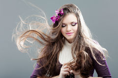 Young woman with long hair Stock Image