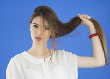 Young Woman with long Hair on blue background Stock Image