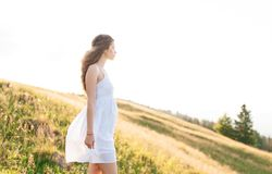 Young woman with long hair looking on a mountain landscape royalty free stock image