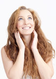 Young Woman with Long Hair Looking up Smiling Royalty Free Stock Images