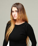 Young woman with long hair. Portrait of a young woman with long hair in a black dress Royalty Free Stock Photos