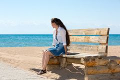 Young woman with long hair posing on a pier Stock Photography