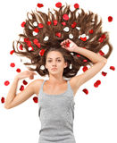 Young woman with long hair and rose petals Stock Photo