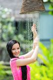 Young woman with long hair under the shower on tropical beach Royalty Free Stock Photography