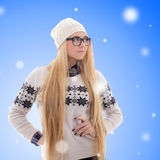 Young woman with long hair in warm winter clothes over christmas Stock Image