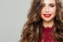 Young Woman with Long Healthy Permed Hair. Portrait of Cute Smiling Girl Fashion Model with Red Lips Makeup Stock Photography